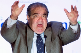 Supreme Court Justice Antonin Scalia makes gestures as he speaks at the Northern Virginia Technology Council's (NVTC) Titans breakfast gathering in McLean, Va., Wednesday, Sept. 25, 2013. Scalia was the featured speaker at the speaker series sponsored by the Council. The 77-year-old justice, currently the longest serving on the nine-member court, is scheduled to discuss the art of persuasion as well as major constitutional issues. (AP Photo/Manuel Balce Ceneta)