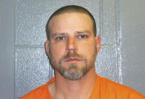 """This Dec. 9, 2015, booking photo provided by the Custer County, Okla., Sheriff's Office shows Jeremy Doss Hardy, who was arrested for DUI after a brief pursuit on Interstate 40 in Custer County, Okla. Oklahoma state police say Hardy, jailed on a preliminary complaint of driving under the influence, is the """"only person'"""" being investigated for a pair of suspected road rage killings along Interstate 40. Jessica Brown, Oklahoma State Bureau of Investigation spokeswoman, said Hardy and his vehicle are the ones described by victims and witnesses as the suspect vehicle involved in the shootings. (Custer County Sheriff's Office via AP)"""